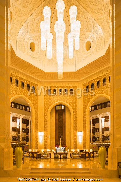Oman. Muscat Governorate, Muscat. The stunning atrium of the Al Bustan Palace, a Ritz Carlton Hotel.