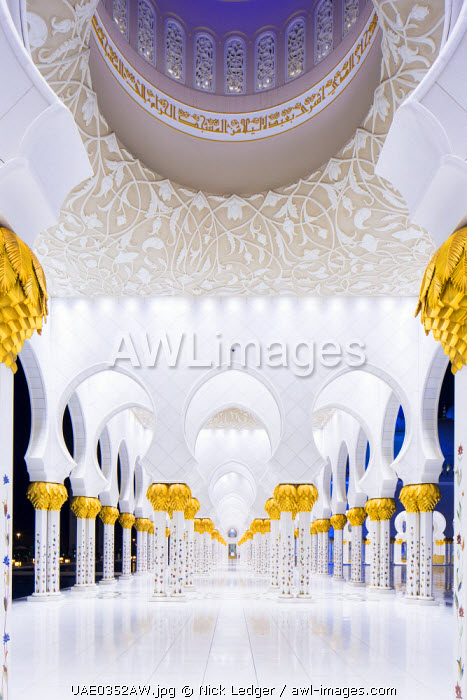 United Arab Emirates, Abu Dhabi. The beautiful date palm-styled column capitals of Sheikh Zayed Grand Mosque. Completed in 2007 the mosque comprises 1096 of these arcade columns.