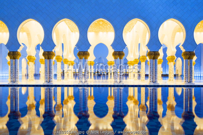 United Arab Emirates, Abu Dhabi. The water pools of Sheikh Zayed Grand Mosque combined with the open colonnades help to provide a significant cooling airflow through to the main courtyard.