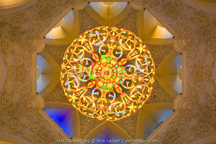 United Arab Emirates, Abu Dhabi. A Swarovski crystal chandelier in the main prayer hall of Sheikh Zayed Grand Mosque hanging beneath an eight-pointed star.