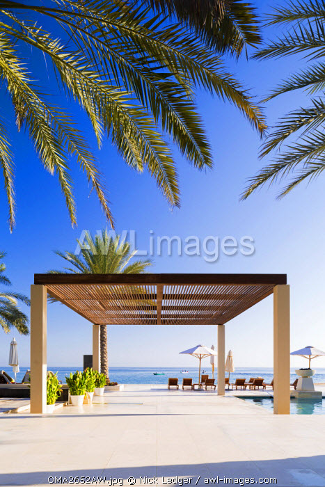 Oman. Muscat Governorate, Muscat. The pool area at Al Bustan Palace Hotel.