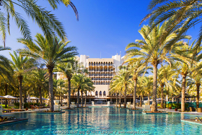 Oman. Muscat Governorate, Muscat. The 50 metre infinity pool at the Ritz Carlton Al Bustan Palace Hotel.