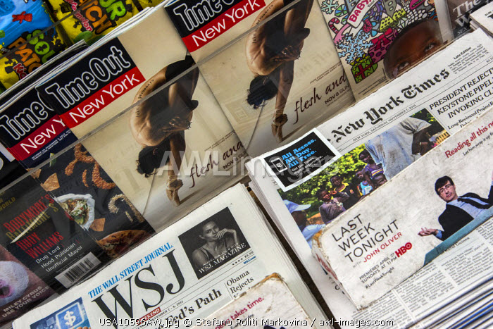 Newspapers and magazines on display at newsagent, Manhattan, New York, USA