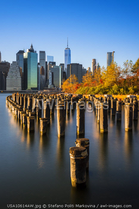 Lower Manhattan skyline at sunset from Brooklyn Bridge Park, Brooklyn, New York, USA