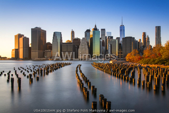 Lower Manhattan skyline at sunset from Brooklyn Bridge Park, Brooklyn, New York, USA