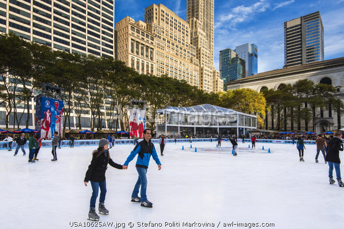 Ice skating in Bryant Park, Manhattan, New York, USA