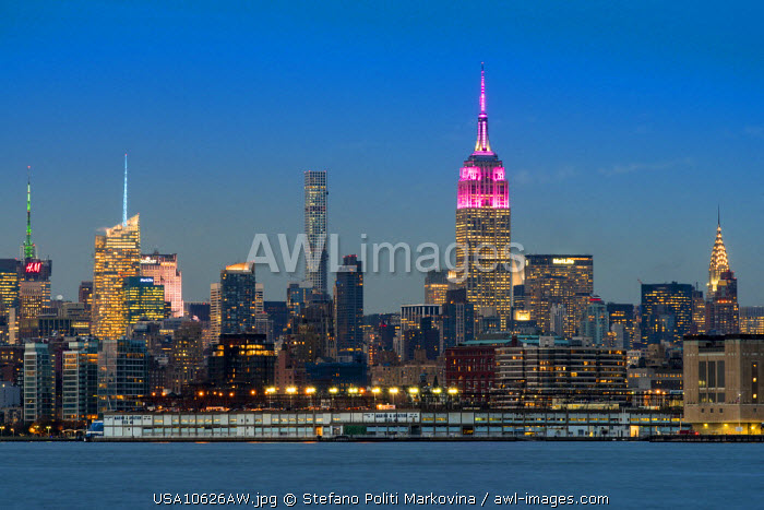Midtown skyline at dusk with the Empire State Building in pink and white colors, Manhattan, New York, USA