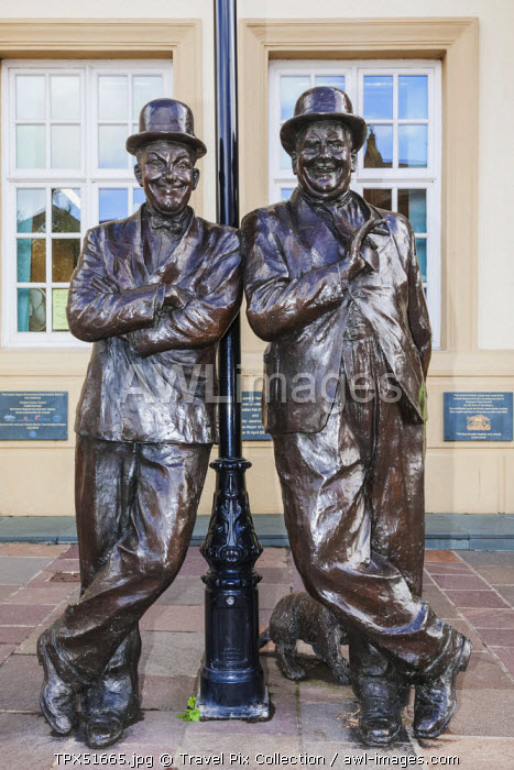 England, Cumbria, Lake District, Ulverston, Statue of Laurel and Hardy in front of The Coronation Hall Theatre