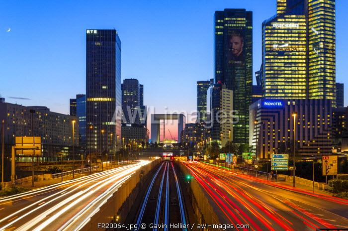 Paris road leading towards La Grand Arche and modern office buildings at La Defense, Paris, France