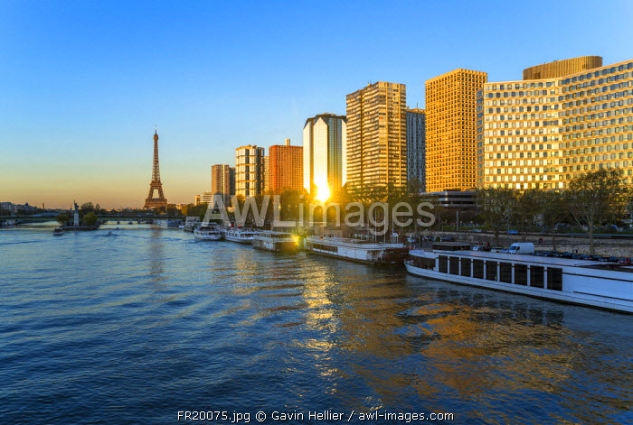 Night view of River Seine with high-rise buildings on the Left Bank, and Eiffel Tower, Paris, France, Europe