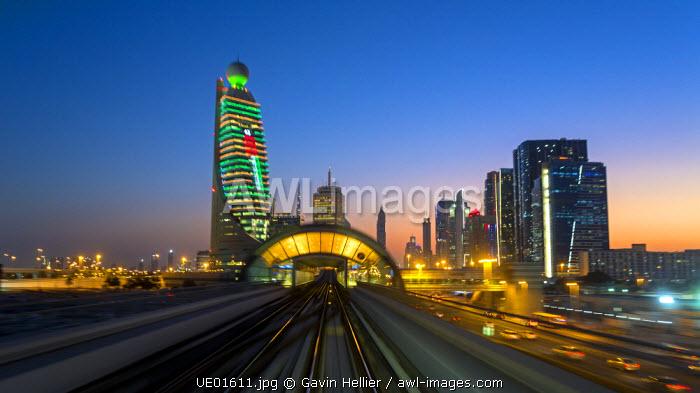 POV on the modern driverless Dubai elevated Rail Metro System, running alongside the Sheikh Zayed Rd, Dubai, UAE