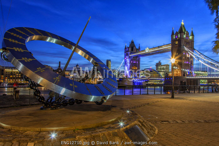 The Tower Bridge in London seen from the east at dusk. In the background the city hall from architect Norman Foster.