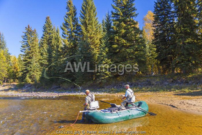 Fly fishermen casting & fishing from boat, British Columbia, Canada