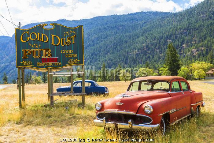 Old American cars outside pub, British Columbia, Canada