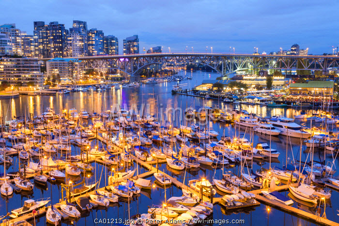 View over harbour & Granville Island with city skyline at dusk, Vancouver, British Columbia, B.C., Canada