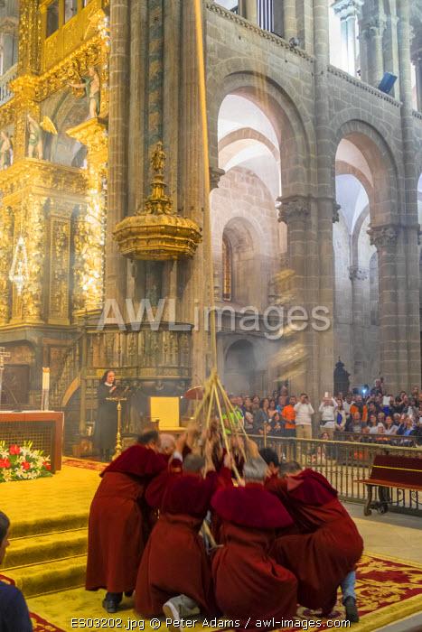 The Botafumeiro an incense burner being swung during service in The Cathedral, Santiago de Compestela, Galicia, Spain