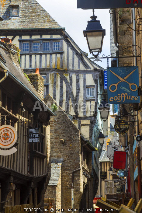 Medieval half-timbered houses and shop signs, Dinan, Brittany, France