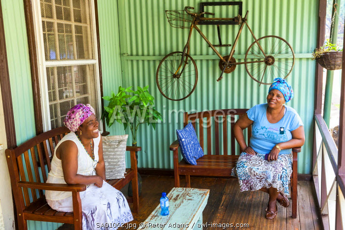 Two ladies on porch of historical building, Pilgrim's Rest, gold mining village from the 1870's, Mpumalanga, South Africa