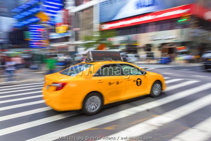 Yellow taxi, central Manhattan, New York, USA