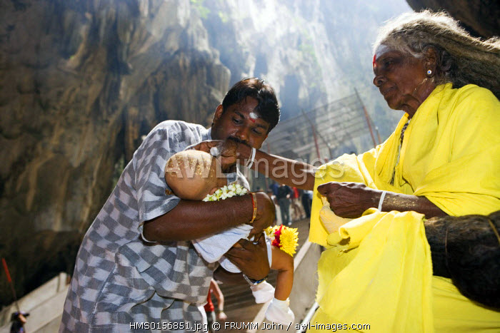 Malaysia, Kuala Lumpur, Batu caves transformed into an hindouist sanctuary and pilgrimage center, saddhu woman giving blessing to the visitors
