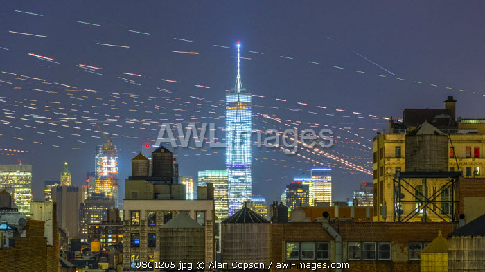 USA, New York, Freedom Tower over rooftops and water tanks. 1hr45mins of aircraft flying overhead