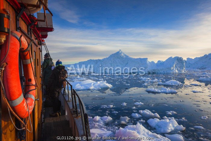 awl-images.com - Greenland / Greenland, Disko Bay, Ilulissat, aboard fishing boat in flaoting ice, sunset