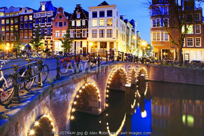awl-images.com - The Netherlands / Europe, Netherlands, Holland, Amsterdam, Joordan, Grachtengordel West, Herengracht, a view east along the Blauwburgwal across the bridge over the Herengracht canal.