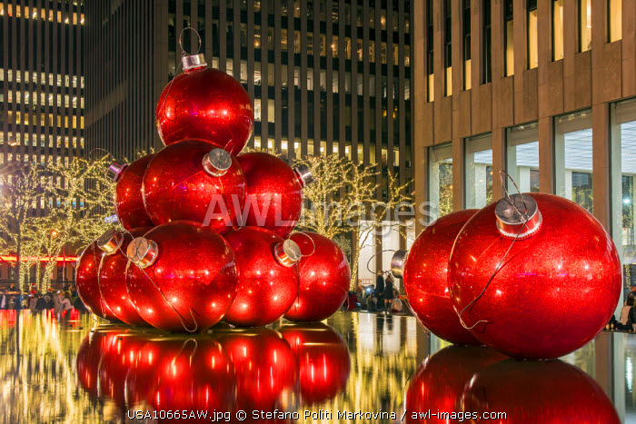 Giant red Christmas ornaments on display on Avenue of Americas (6th Avenue) during the holiday season, Manhattan, New York, USA