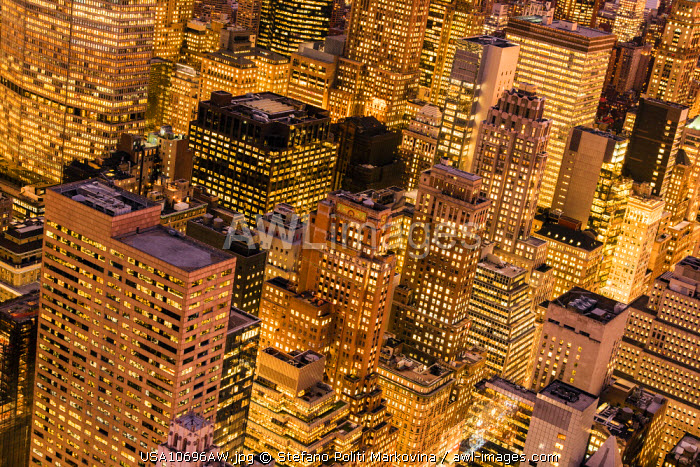 awl-images.com - USA / Top view by night of skyscrapers in Midtown Manhattan, New York, USA