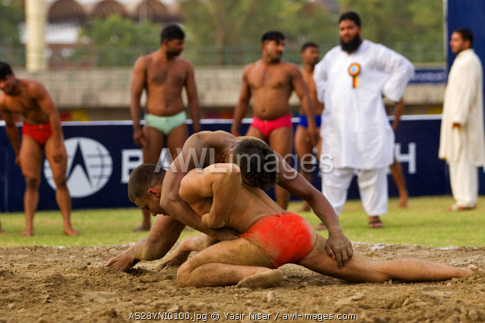 Local wrestlers in a traditional match in Lahore, Pakistan