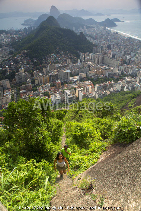 awl-images.com - Brazil / South America, Brazil, Rio de Janeiro, View of Copacabana, Sugar Loaf and Rio city from the summit of Cabritos hill