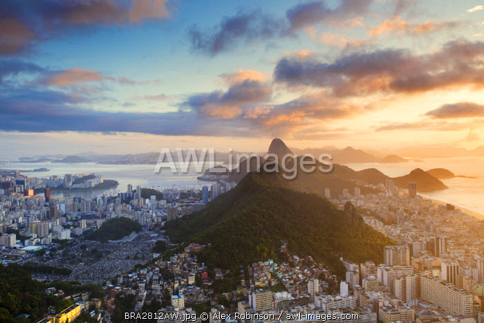 awl-images.com - Brazil / South America, Brazil, Rio de Janeiro, View of Copacabana, Sugar Loaf and Rio city from the summit of Cabritos hill at dawn