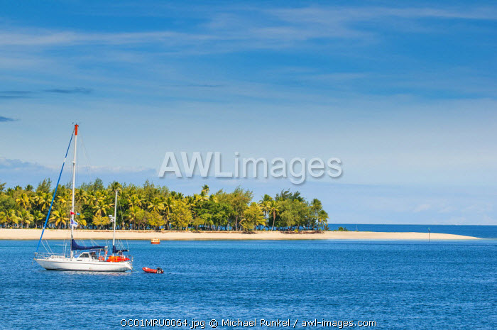 Little sailboat in the blue lagoon, Yasawa, Fiji, South Pacific