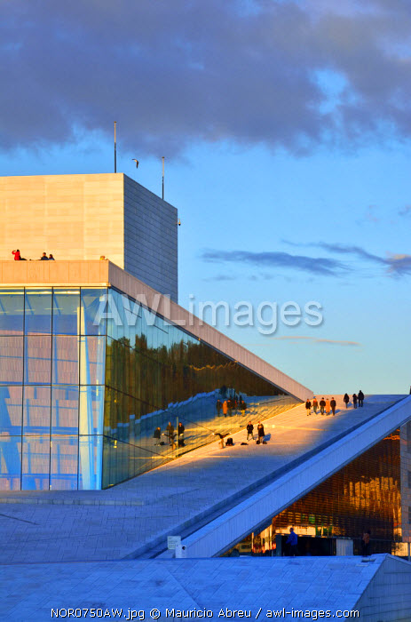 The Opera House, Norwegian National Opera and Ballet, by Snohetta architects in Bjorvika district, in the evening. Oslo, Norway