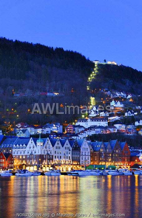 The Bryggen District, a former counter of the Hanseatic League and nowadays a UNESCO World Heritage Site. Mount Floyen at twilight. Bergen, Norway
