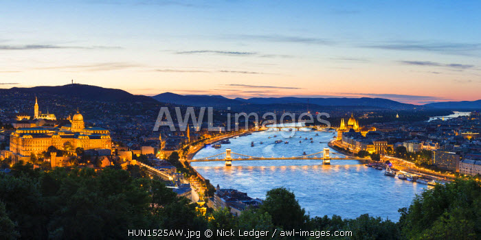 Hungary, Central Hungary, Budapest. Evening view over Budapest and the Danube from Gellert Hill.