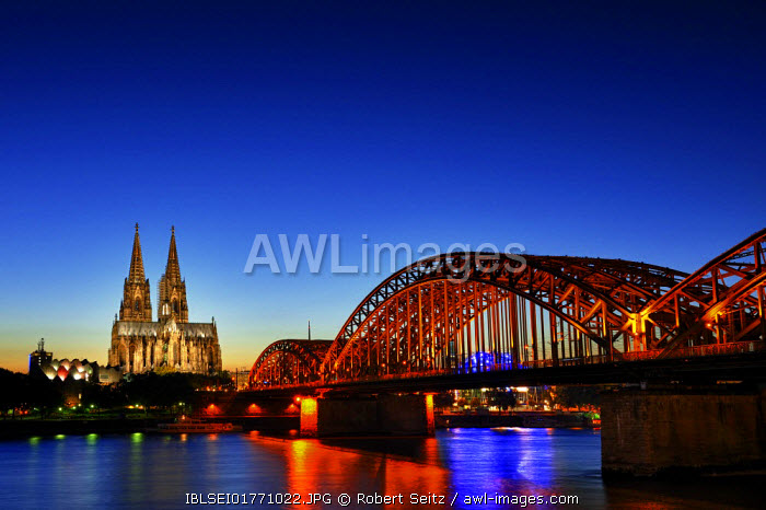 awl-images.com - Germany / Cologne Cathedral at the blue hour with Hohenzollernbruecke railway bridge, Cologne, North Rhine-Westphalia, Germany