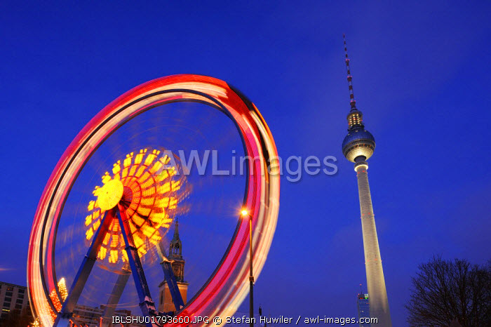 awl-images.com - Germany / Ferris wheel in motion with TV Tower, Alexanderplatz, Berlin, Germany