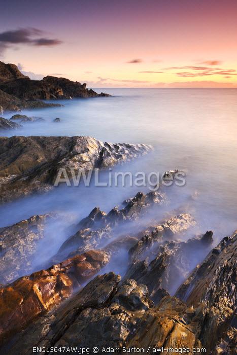 Rocky coast at Sunset, Leas Foot Sand, Thurlestone, South Hams, Devon, England. Winter (January) 2010.