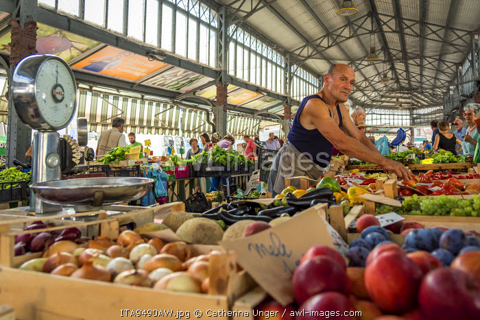 Europe, Italy, Piedmont. Fruit seller at the Porta Palazzo market in Turin.