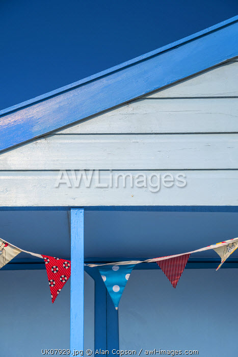 UK, England, Suffolk, Southwold, Promenade, Bunting decorating a Beach Hut