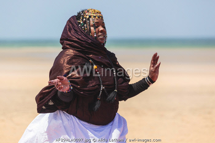Africa, Western Sahara, Dakhla. Woman in tradition dress performing a dance for tourists.