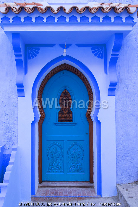 Morocco, Chefchaouen. A traditional door and entrance to a home in the village.