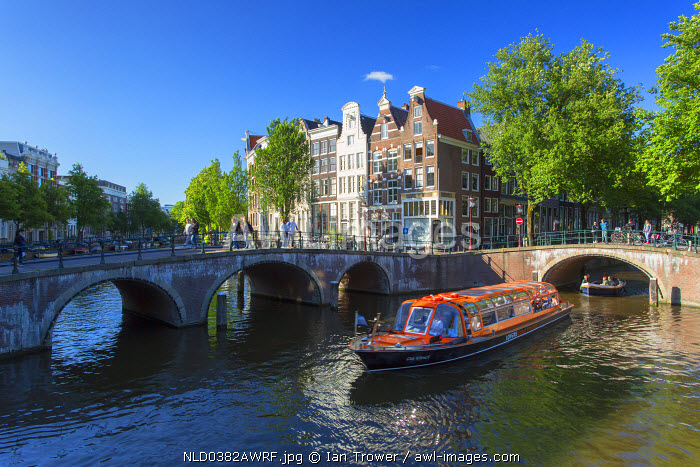 Tourist boats on Prinsengracht canal, Amsterdam, Netherlands