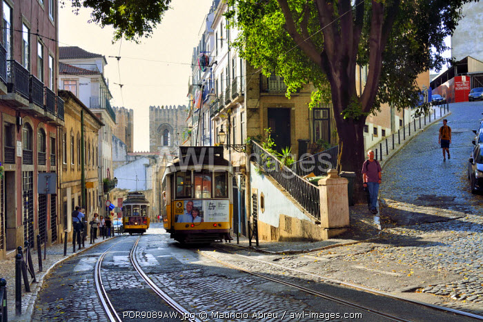 A tramway in Alfama district with the Motherchurch (Se Catedral) in the background. Lisbon, Portugal