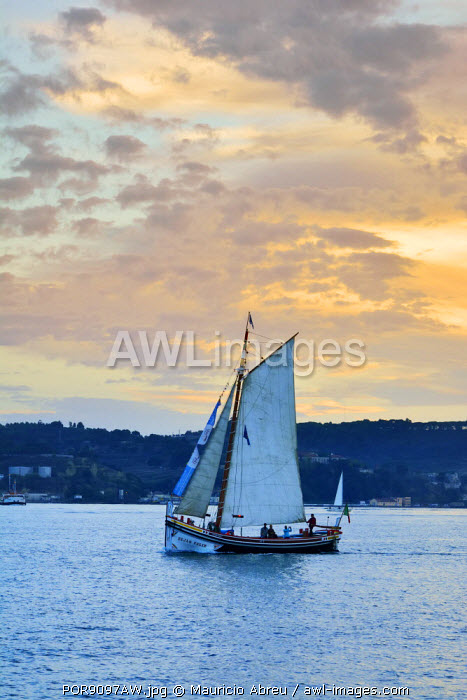 A traditional boat (Fragata do Tejo) crossing the Tagus river in the evening. Lisbon, Portugal