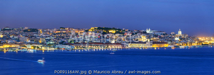 The Tagus river (Tejo river) and the historic centre of Lisbon at twilight. Portugal