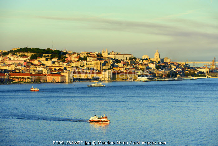 The Tagus river (Tejo river) and the historic centre of Lisbon in the evening. Portugal