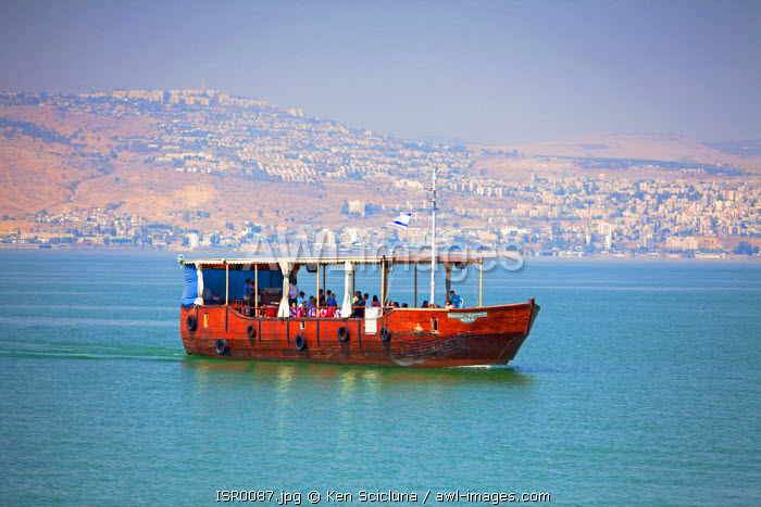 Israel, Galilee. A copy of a traditional wooden boat mentioned in the bible crossing the Sea of Galilee.