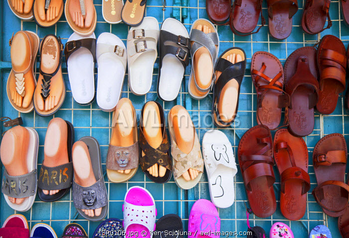Israel, Akko. Shoes on display at an outlet in the market. Unesco.